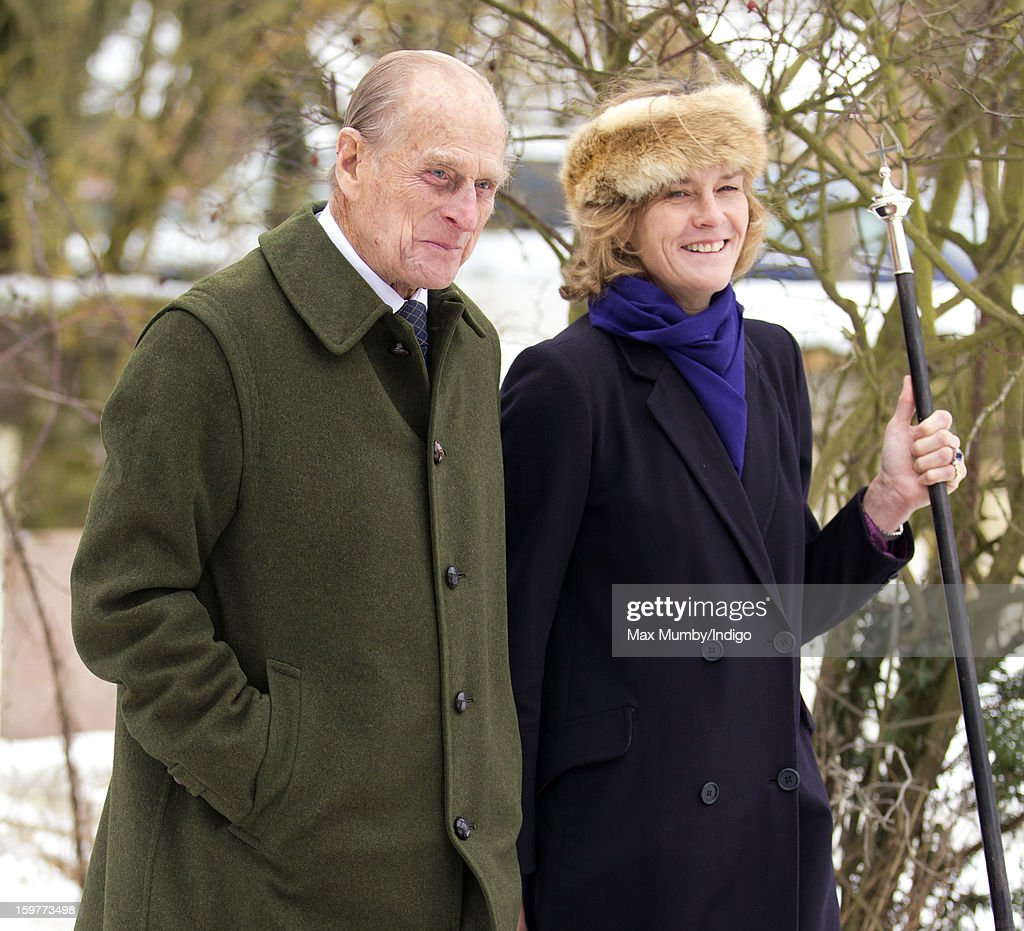Prince Philip, Duke of Edinburgh walks through the snow covered church yard after attending Sunday Service along with Queen Elizabeth II at the Church of St Lawrence in Castle Rising near the Sandringham Estate on January 20, 2013 near King's Lynn, England.