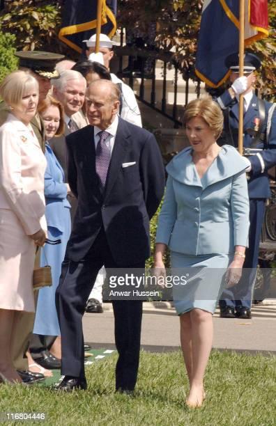Prince Philip Duke of Edinburgh walks with Laura Bush at the White House Washington DC on May 7 2007