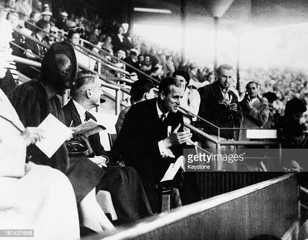 Prince Philip Duke of Edinburgh watching events at the Olympic Stadium during the Olympic Games in Helsinki 26th July 1952