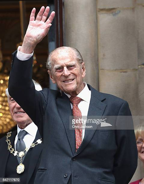Prince Philip Duke of Edinburgh waves from the balcony of the Town Hall during a visit to Liverpool on June 22 2016 in Liverpool England