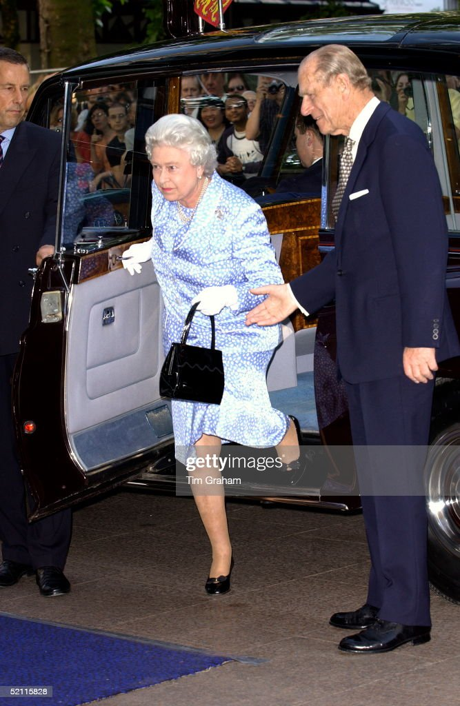 prince-philip-gallantly-helping-his-wife-queen-elizabeth-ii-as-she-picture-id52115828