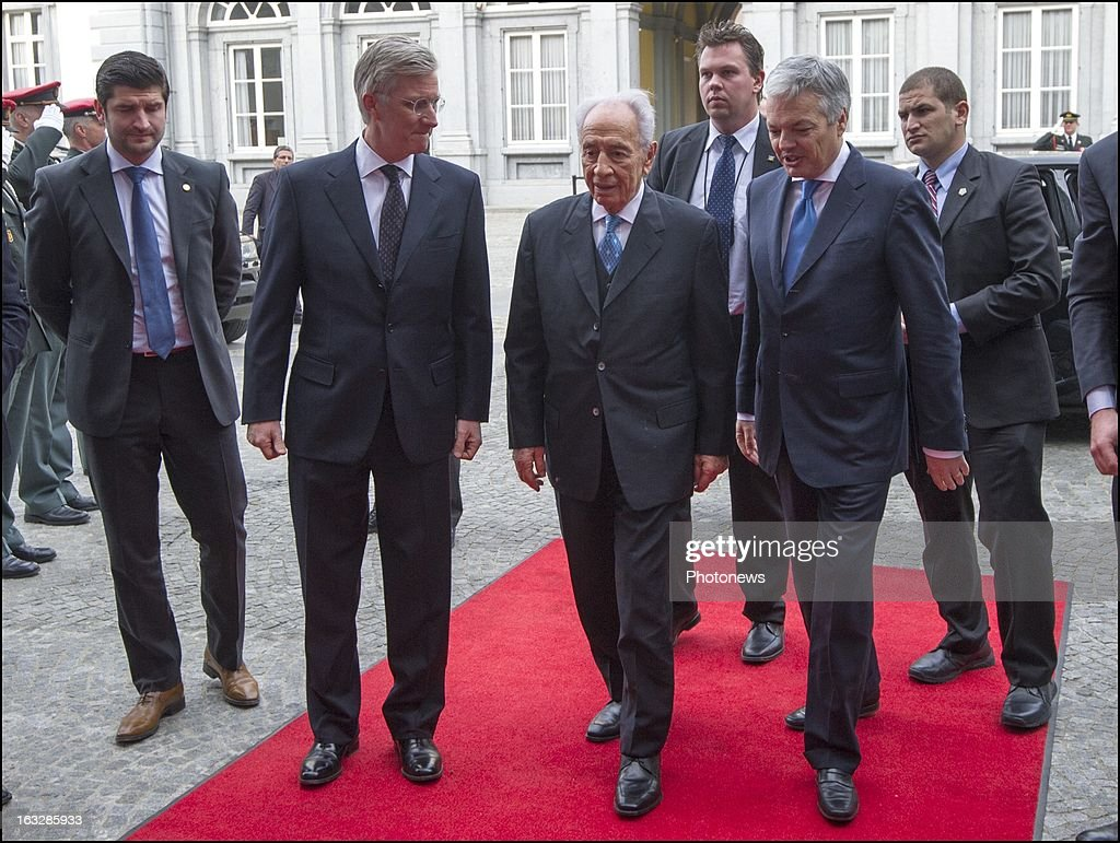 Prince Philip of Belgium meets with President of Israel <a gi-track='captionPersonalityLinkClicked' href=/galleries/search?phrase=Shimon+Peres&family=editorial&specificpeople=201775 ng-click='$event.stopPropagation()'>Shimon Peres</a> and Minister <a gi-track='captionPersonalityLinkClicked' href=/galleries/search?phrase=Didier+Reynders&family=editorial&specificpeople=548982 ng-click='$event.stopPropagation()'>Didier Reynders</a> during a ceremony to award Belgian families with the Righteous Among the Nations for saving Jewish citizens on March 5, 2013 in Brussels , Belgium. 11 Belgian families were decorated with the Righteous Among the Nations for saving Jewish citizens during World War II.