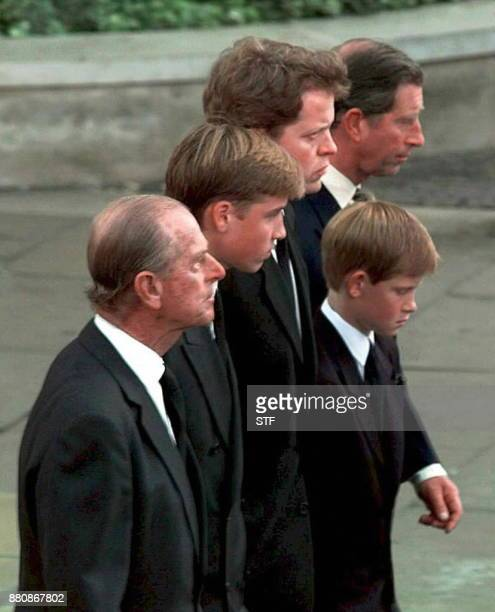 Prince Philip Prince William Earl Spencer Diana's brother Prince Harry and Prince Charles walk together behind the carriage carrying the casket of...