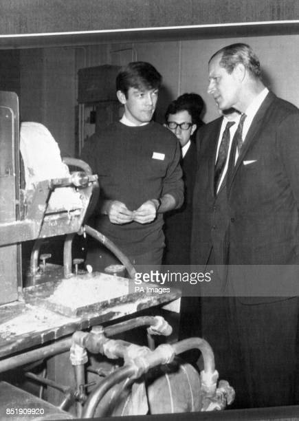 Prince Philip The Duke of Edinburgh and Chancellor of Salford University is shown a demonstration by Student R Archibald a young student from...