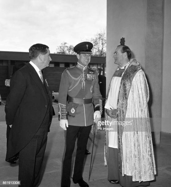Prince Philip The Duke of Edinburgh and Colonel The Welsh Guards is flanked by Mr Denis Healey the Secretary of State for Defence and The Venerable...