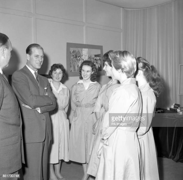 Prince Philip The Duke of Edinburgh chats to some of the girls who work at the Carreras Tobacco Factory at Basildon in Essex during his visit to the...