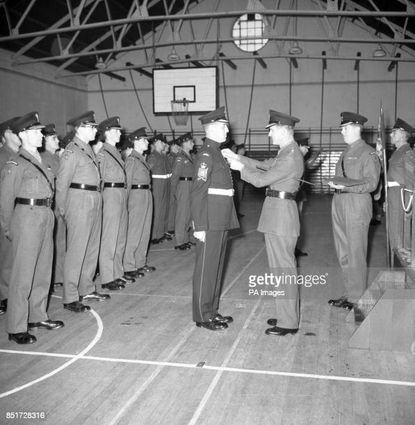 Prince Philip The Duke of Edinburgh Colonel of the Welsh Guards is seen presenting the British Empire Medal to Company Sergeant Major H Brawn during...