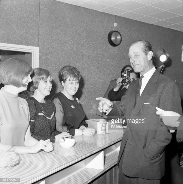 Prince Philip The Duke of Edinburgh during a visit to the North Paddington Boys club where he found himself facetoface with helpers in the canteen of...