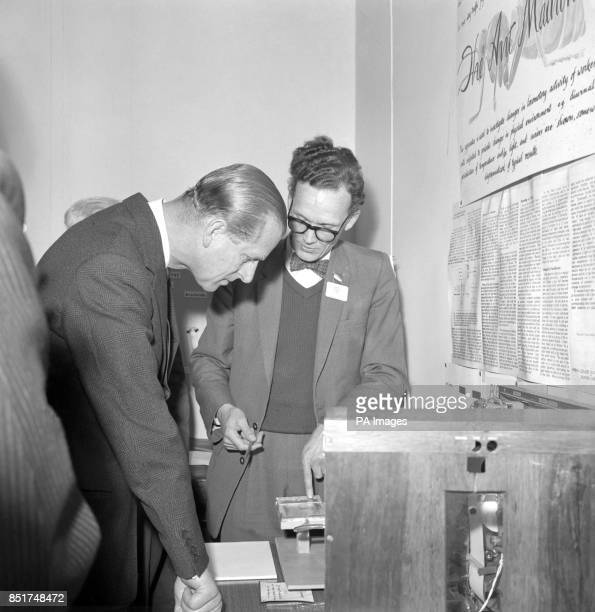 Prince Philip The Duke of Edinburgh engrossed in the activities of ants during his visit to Britain's first Wildlife Exhibition at the Royal...