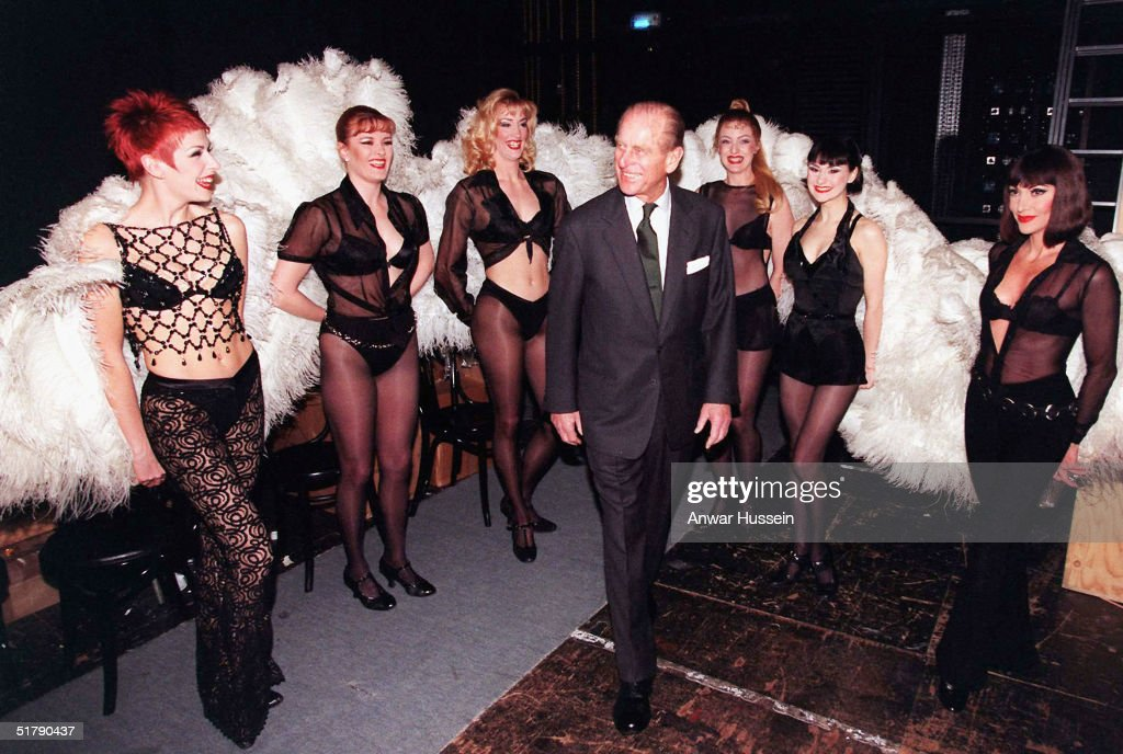 Prince Philip, the Duke of Edinburgh meets members of the cast of Chicago during a visit to the Adelphi Theatre in this March 4, 1999 file photo in London, England.
