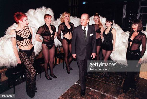 Prince Philip the Duke of Edinburgh meets members of the cast of Chicago during a visit to the Adelphi Theatre in this March 4 1999 file photo in...
