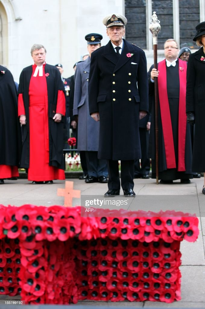 Prince Philip, The Duke of Edinburgh (C) pays his respects during his visit to the Field of Remembrance at Westminster Abbey in London on November 8, 2012. AFP PHOTO/POOL/JON BOND