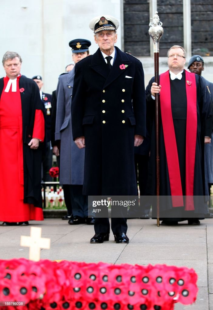 Prince Philip, The Duke of Edinburgh (C) pays his respects during his visit to the Field of Remembrance at Westminster Abbey in London on November 8, 2012.