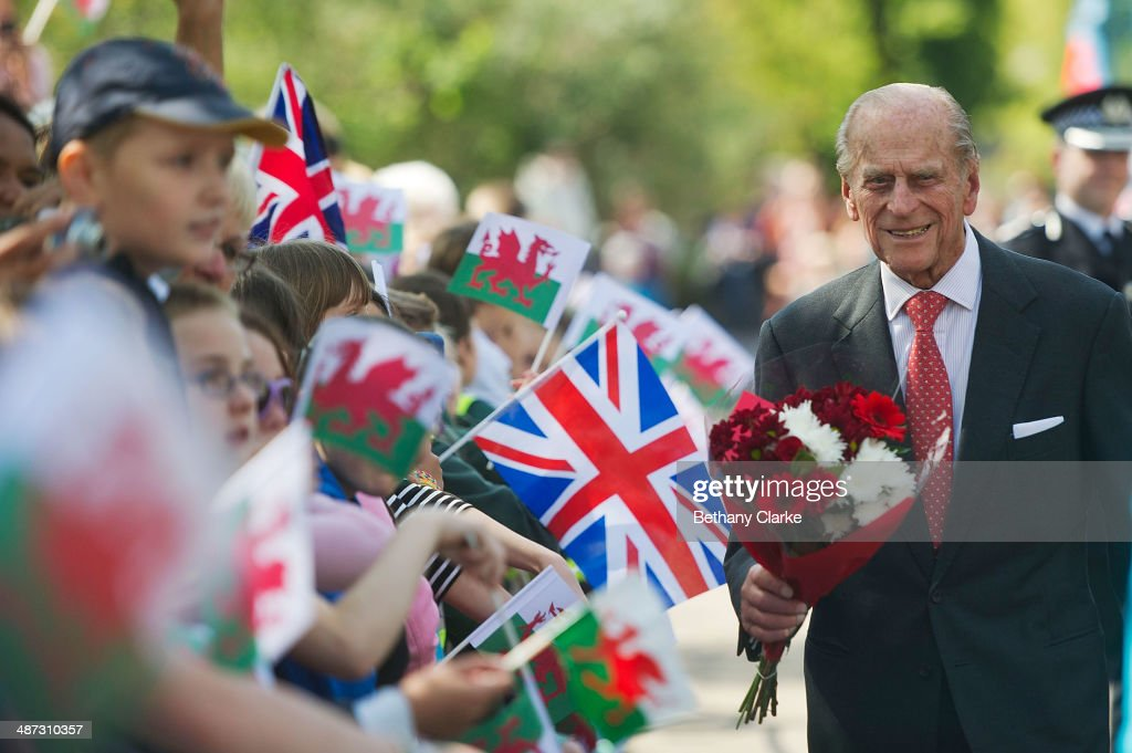 Prince Philip, The Duke of Edinburgh, receives flowers from local children at the Royal Dockyard Chapel during an official visit on April 29, 2014 in Pembroke Dock, United Kingdom. This year sees the 200th anniversary of the town of Pembroke Dock. The Royal Dockyard Chapel has undergone a restoration project to become the base for Pembroke Dock's Heritage Centre which celebrates 200 years of a unique naval and military community.