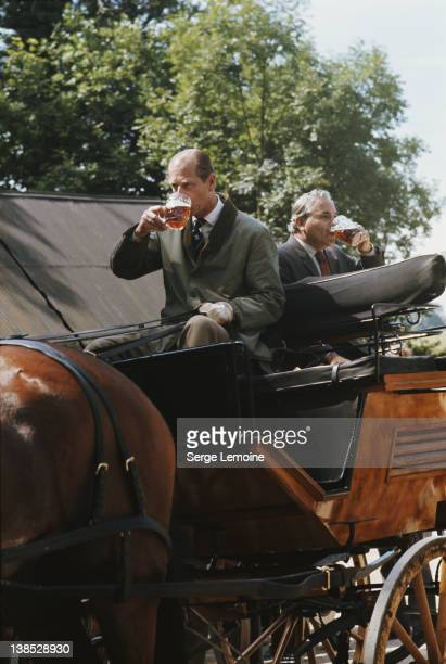 Prince Philip the Duke of Edinburgh refreshes himself with a beer during a carriage driving event circa 1980