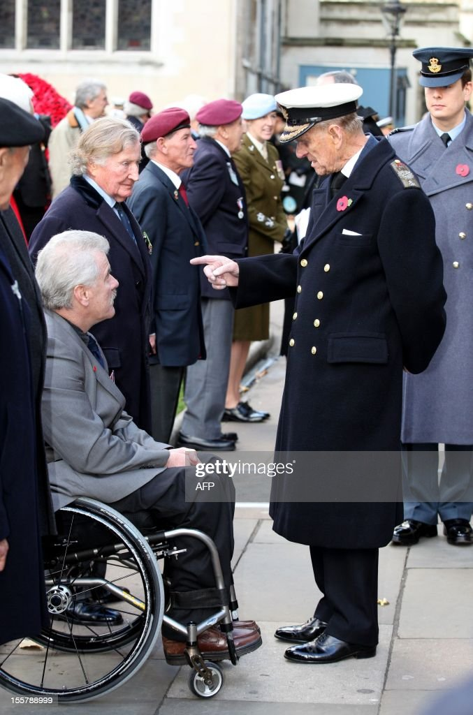 Prince Philip, The Duke of Edinburgh (R) speaks with war veterans during his visit to the Field of Remembrance at Westminster Abbey in London on November 8, 2012.