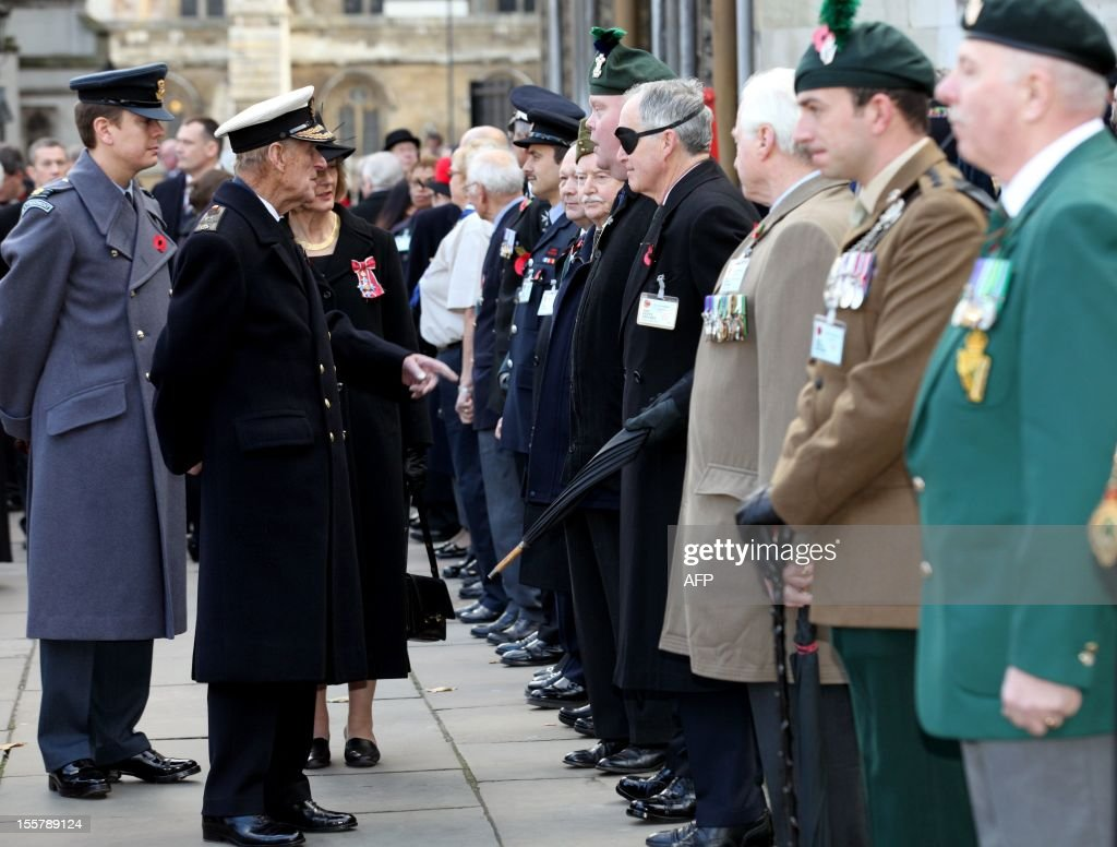 Prince Philip, The Duke of Edinburgh (L) speaks with war veterans during his visit to the Field of Remembrance at Westminster Abbey in London on November 8, 2012.