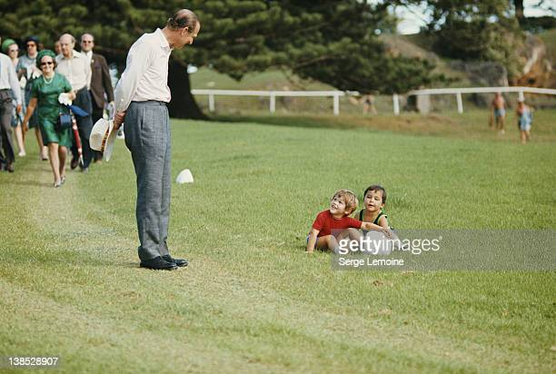 Prince Philip the Duke of Edinburgh stops to chat with two toddlers circa 1980