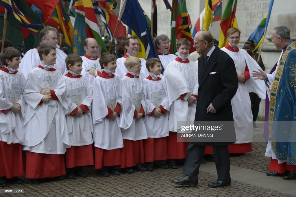 Prince Philip, the Duke of Edinburgh (Foreground 2-R) walks past choir boys as he arrives for the Commonwealth Observance ceremony at Westminster Abbey in London on March 11, 2013. Britain's Queen Elizabeth II missed the Commonwealth Day service in London as she is still recovering from the symptoms of gastroenteritis, Buckingham Palace said. Her 91-year-old husband Prince Philip represented her at the service, which was attended by Commonwealth ambassadors, or high commissioners, from around the world and featured an address from Virgin tycoon Richard Branson. AFP PHOTO/ADRIAN DENNIS