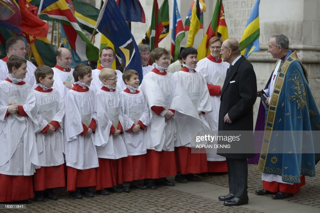 Prince Philip, the Duke of Edinburgh (Foreground 2-R) walks past choir boys as he arrives for the Commonwealth Observance ceremony at Westminster Abbey in London on March 11, 2013. Britain's Queen Elizabeth II missed the Commonwealth Day service in London as she is still recovering from the symptoms of gastroenteritis, Buckingham Palace said. Her 91-year-old husband Prince Philip represented her at the service, which was attended by Commonwealth ambassadors, or high commissioners, from around the world and featured an address from Virgin tycoon Richard Branson.