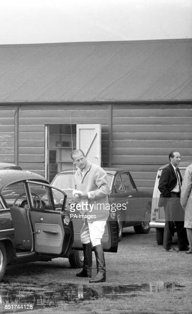 Prince Philip The Duke of Edinburgh who was to have played polo at Windsor until all matches were abandoned there after a rain deluge takes a duster...