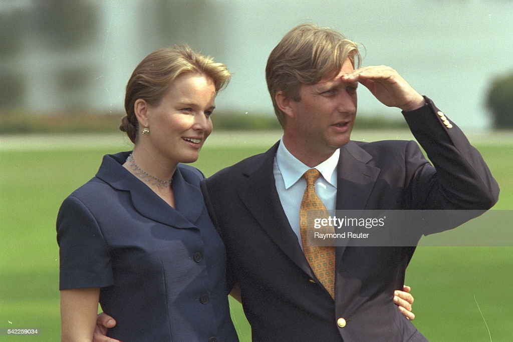 Prince Philippe and his fiancee pose in the park at Laeken Chateau