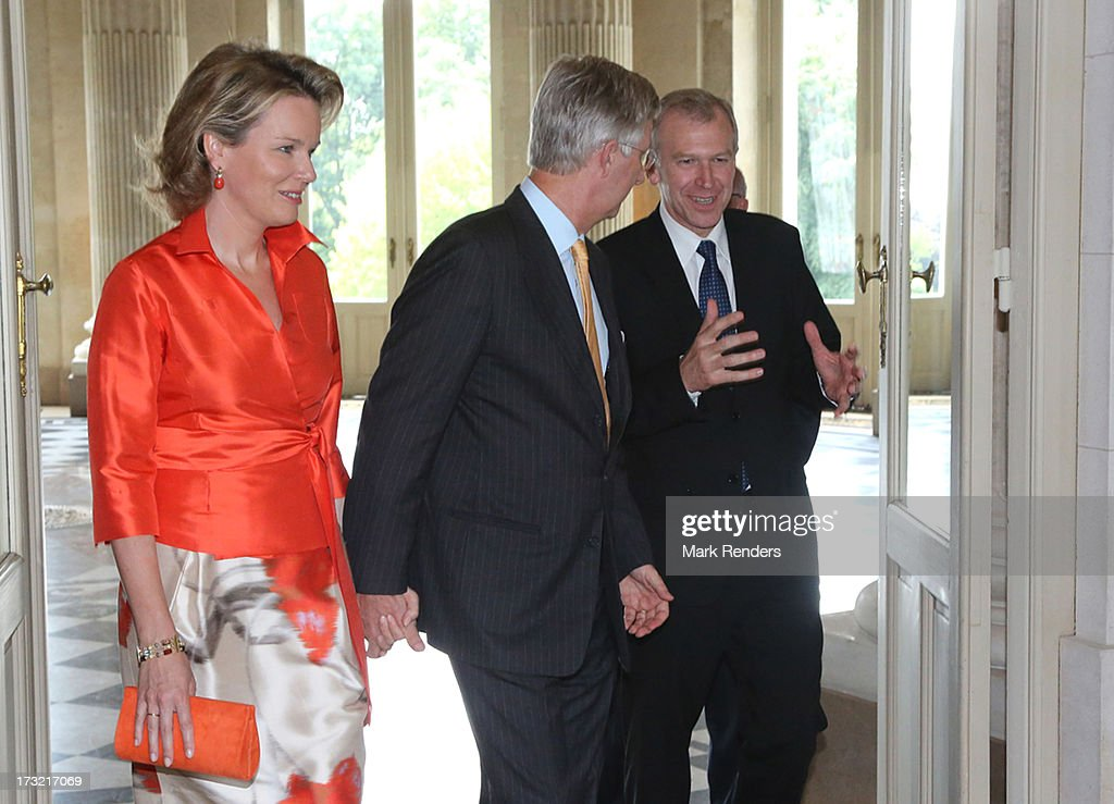 Prince Philippe (C) and Princess Mathilde of Belgium meet former Prime Minister of Belgium <a gi-track='captionPersonalityLinkClicked' href=/galleries/search?phrase=Yves+Leterme&family=editorial&specificpeople=552852 ng-click='$event.stopPropagation()'>Yves Leterme</a> at Laeken Castle on July 10, 2013 in Brussels, Belgium.