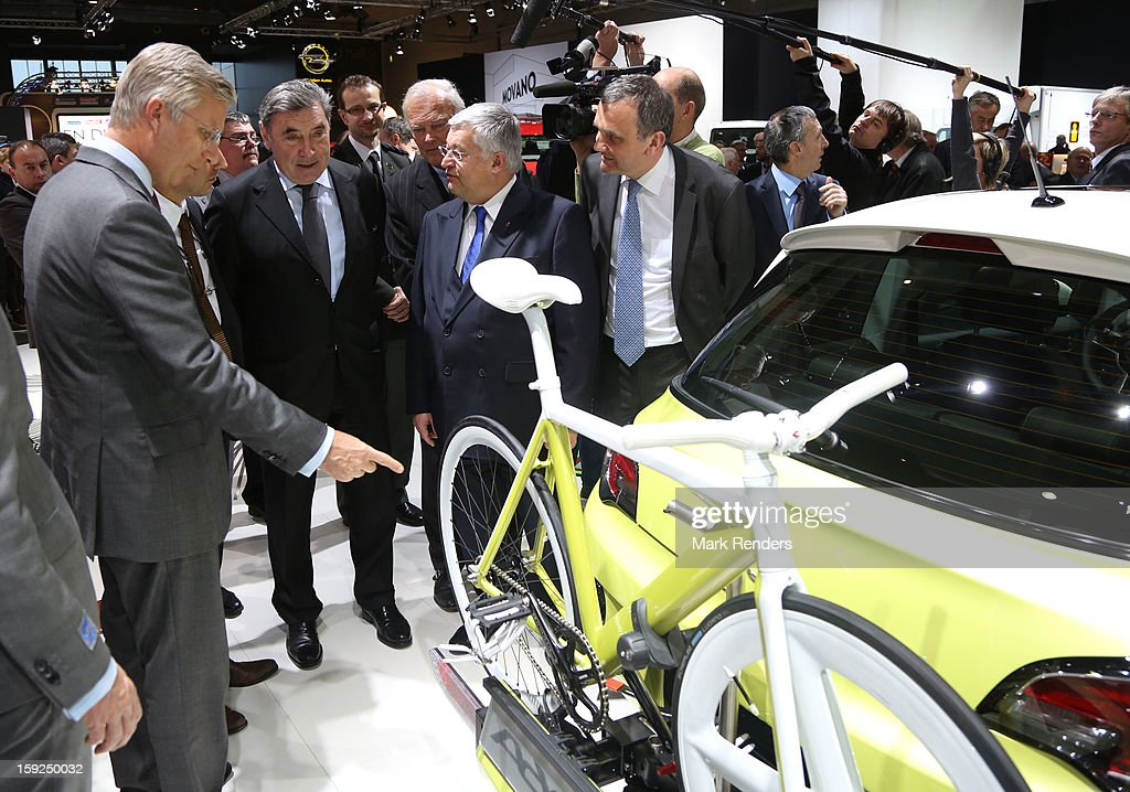 Prince Philippe of Belgium and cyclist Eddy Merckx is displayed at the 91st edition of the European Motor Show at Brussels Expo on January 10, 2013 in Brussels, Belgium.