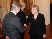 Prince Philippe of Belgium and EC Vice President Viviane Reding shake hands during a reception for the European Authorities at the Royal Palace on...