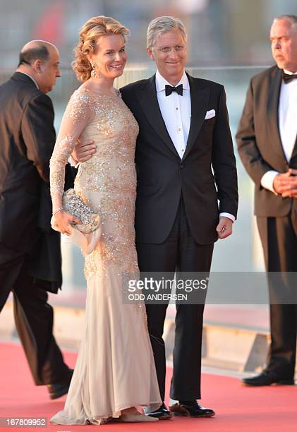 Prince Philippe of Belgium and his wife Princess Mathilde pose on April 30 2013 prior to take part in a water pageant on the day of the new King's...