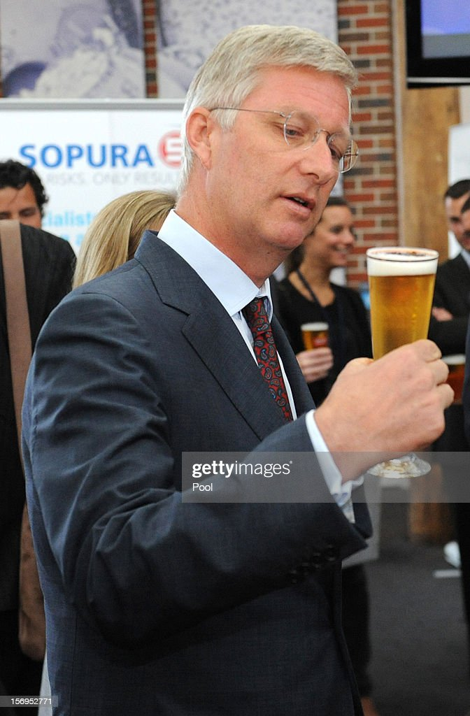 Prince <a gi-track='captionPersonalityLinkClicked' href=/galleries/search?phrase=Philippe+of+Belgium&family=editorial&specificpeople=160209 ng-click='$event.stopPropagation()'>Philippe of Belgium</a> drinks a Crown Lager beer at Carlton BrewHouse on November 26, 2012 in Melbourne, Australia. Prince Philippe is on a ten-day tour of Australia that will take him to Perth, Sydney, Canberra and Melbourne.