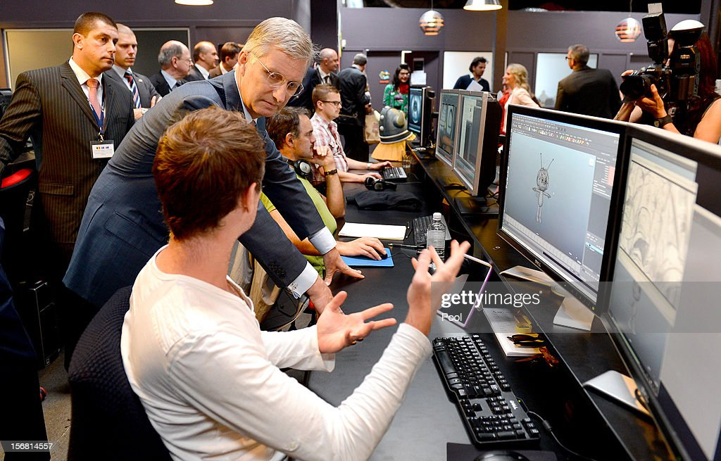 Prince Philippe of Belgium (C) looks at the animation on the screens as he talks to members of the creative team during a tour of Flying Bark Productions on November 22, 2012 in Sydney, Australia. Prince Philippe is on a ten-day tour of Australia that will take him to Perth, Sydney, Canberra and Melbourne.