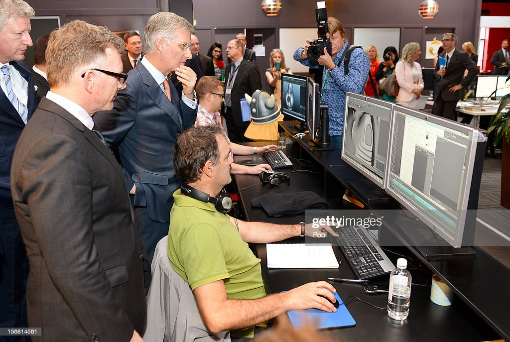 Prince Philippe of Belgium (3/L) looks at the animation on the screens as he talks to members of the creative team during a tour of Flying Bark Productions on November 22, 2012 in Sydney, Australia. Prince Philippe is on a ten-day tour of Australia that will take him to Perth, Sydney, Canberra and Melbourne.