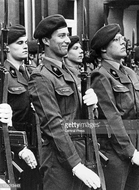 Prince Philippe of Belgium notices his parents amongst the spectators at the ceremony for the promotion parade being held at the Royal Military...