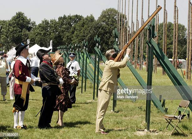 Prince Philippe of Belgium shoots an old gun as he and Queen Beatrix of the Netherlands visit 'het Oud Limburgs Schuttersfeest' the 100th anniversary...
