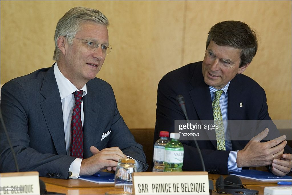 Prince Philippe of Belgium (L) talks with Pierre-Olivier Beckers during a visit to the headquarters of the IOC on May 13, 2013 in Lausanne, Switzerland.