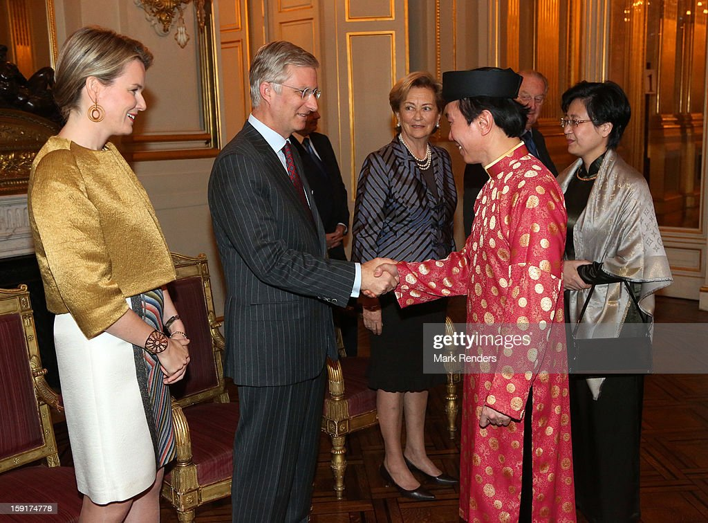 Prince Philippe (2nd L), Princess Mathilde (L) and Queen Paola (3rd L) of Belgium meet Ambassador of Uzbekistan Bakhiyar Gulyamov at Palais de Bruxelles on January 9, 2013 in Brussel, Belgium.