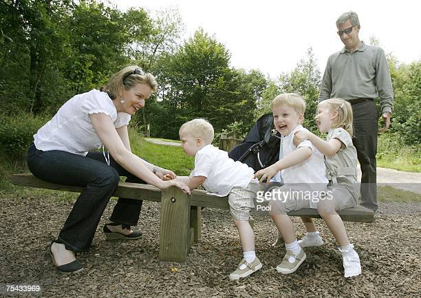 Prince Philippe Princess Mathilde of Belgium and their children Princess Elisabeth Prince Gabriel and Prince Emmanuel of Belgium play in Park...