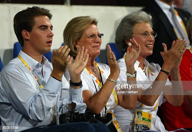 Prince Philippos of Greece Queen AnneMarie of Greece and Princess Benedikte of Denmark watch Princess Nathalie von SaynWittgensteinBerleburg and...