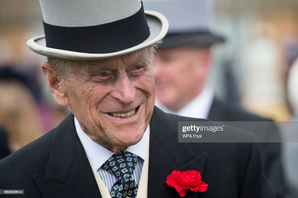 Prince Phillip, Duke of Edinburgh talks to guests during a garden party at Buckingham Palace on May 16, 2017 in London, England.