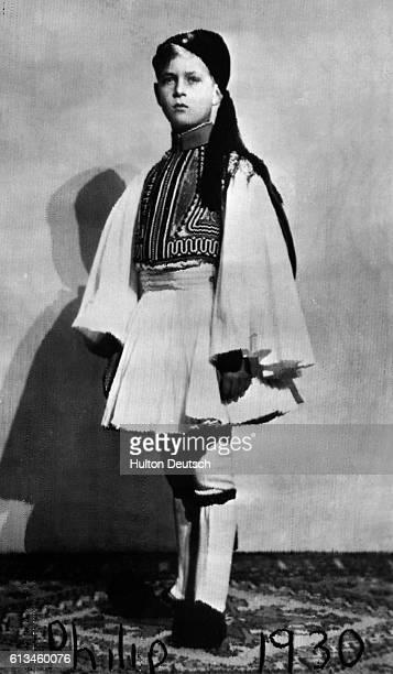 Prince Phillip of Greece later the Duke of Edinburgh wearing traditional Greek dress aged 9