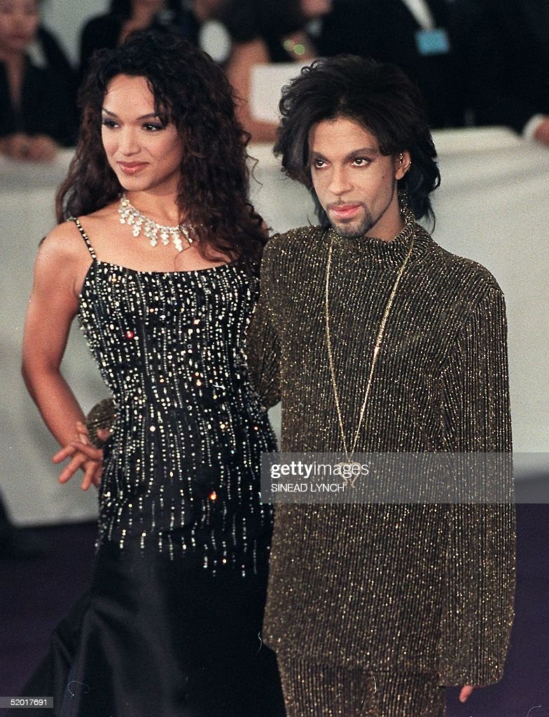 Prince poses for photographers with his wife Mayte as they arrives at the De Beer and Versace 'Diamonds are forever' charity fashion event 09 June...