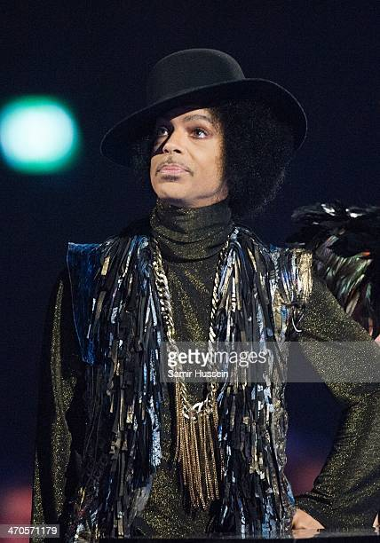 Prince presents an award at The BRIT Awards 2014 at The O2 Arena on February 19 2014 in London England