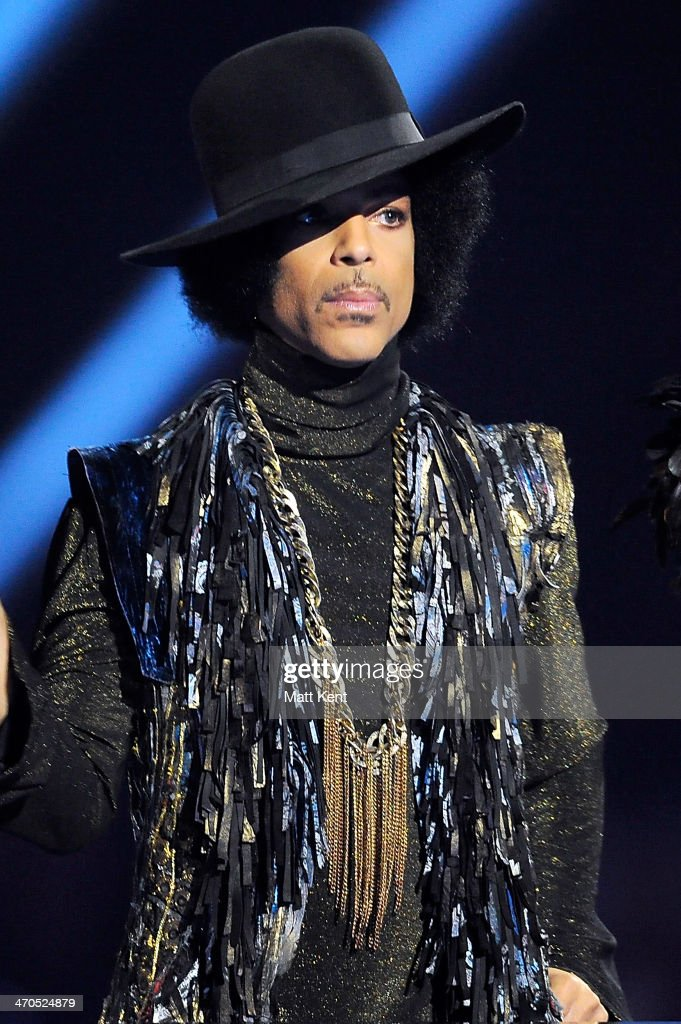 Prince presents the award for British Female Solo Artist at The BRIT Awards 2014 at 02 Arena on February 19 2014 in London England