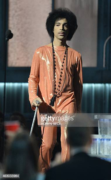 Prince presets an award on stage at the 57th Annual Grammy Awards in Los Angeles February 8 2015 AFP PHOTO/ROBYN BECK
