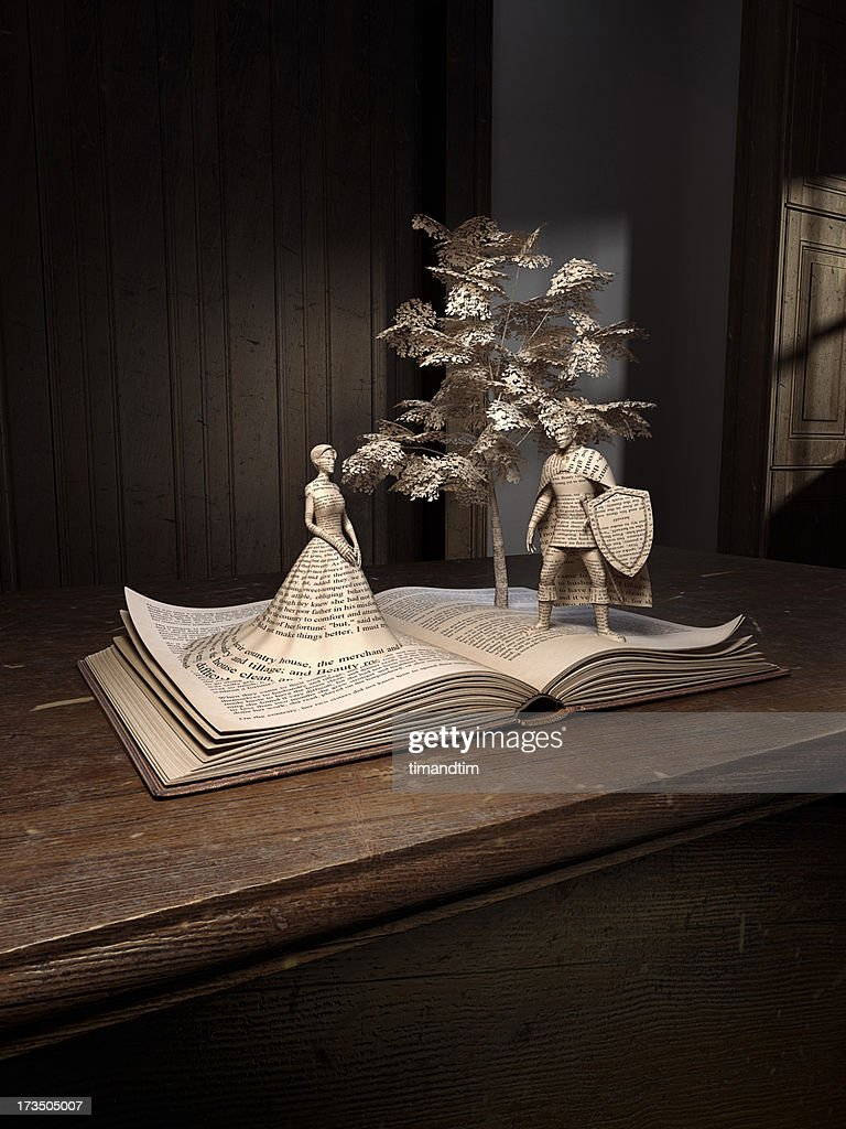Prince, princess, tree popping up from an old book : Stock Photo