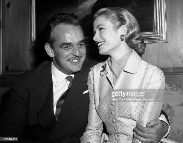 Prince Rainier III of Monaco and Grace Kelly pose for photographers at the Kelly home in Philadelphia after announcing their engagement yesterday