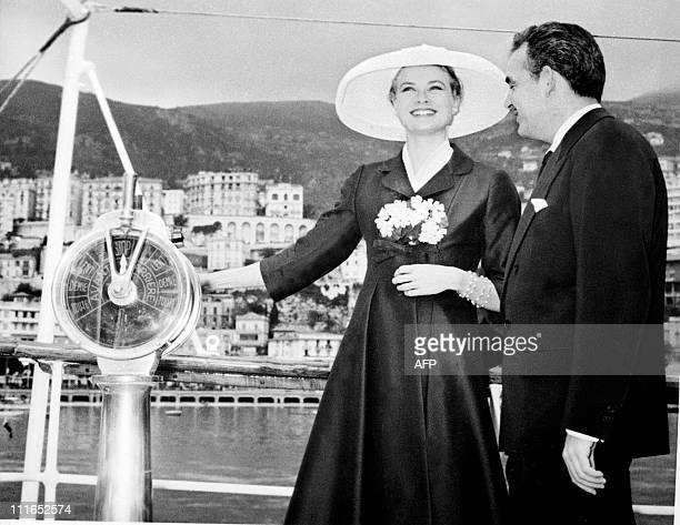 Prince Rainier III of Monaco and his fiancee US actress Grace Kelly are all smile aboard the princely yacht 'Deo Juvante II' on April 12 1956 in...