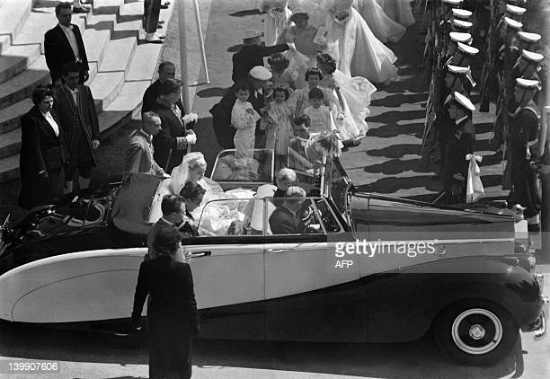 Prince Rainier III of Monaco and US actress and princess of Monaco Grace Kelly leave Saint Nicholas Cathedral after their wedding ceremony in Monaco...