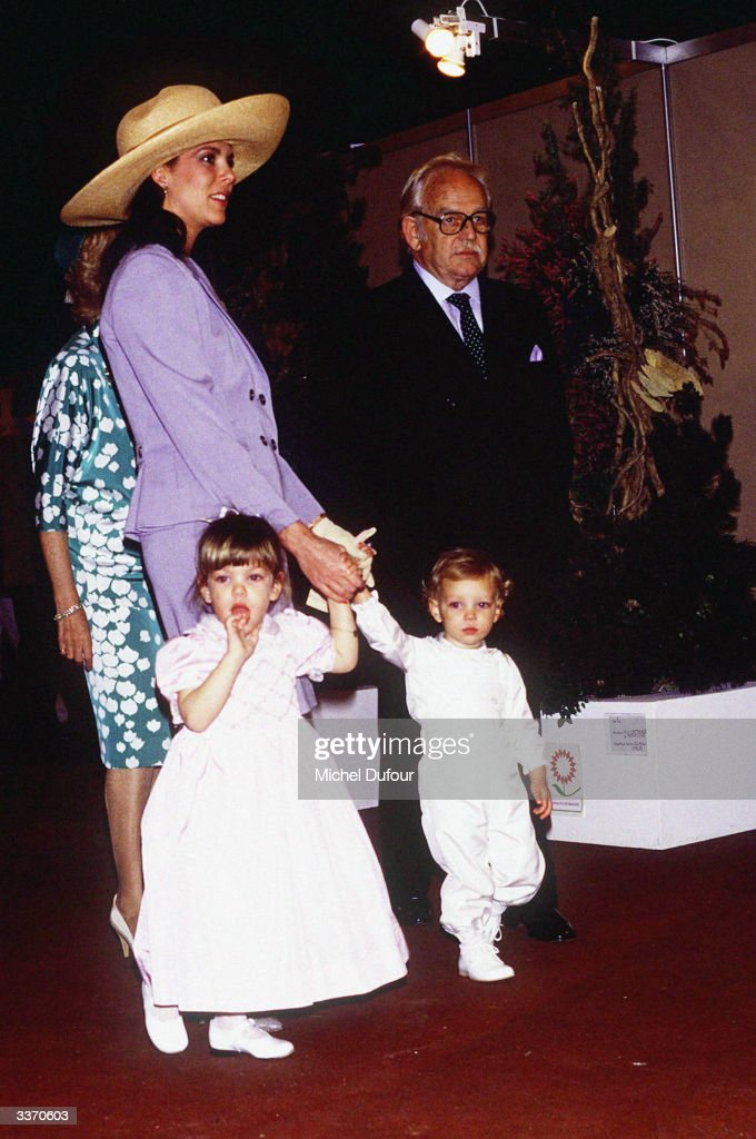 Prince Rainier III of Monaco arrives with daughter Princess Caroline and her children Charlotte and Pierre at Fontvielle for the Flower Show in April 1989 in Monte Carlo, Monaco.